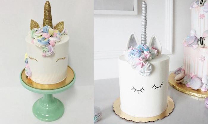 hier ist eine weiße torte mit einem weißen einhorn mit einer mähne aus sahne und mit einem großen horn und kleinen augen