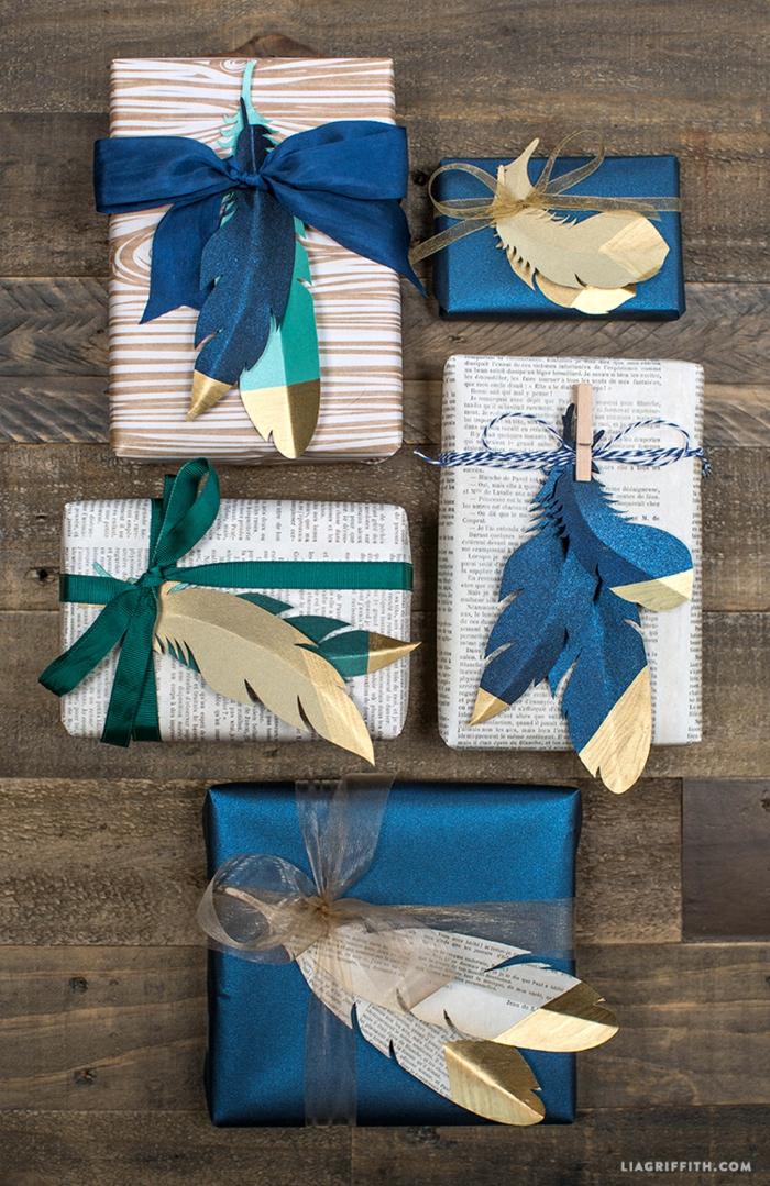 Kreative Ideen für Geschenkverpackungen, Federn aus Papier schneiden und mit Band befestigen