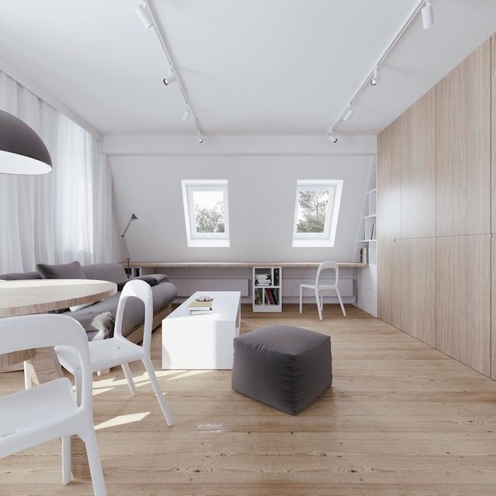 zimmer mit dachschräge fenster an der wand grau weiß beige farben im zimmer dezente einrichtung skandinavischer stil