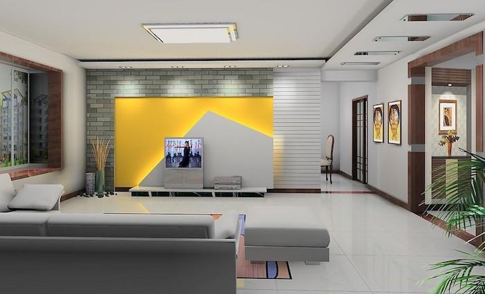 tv paneel grau gelbes design an der wand wanddeko ideen wandbilder graues sofa hocker wandfarben