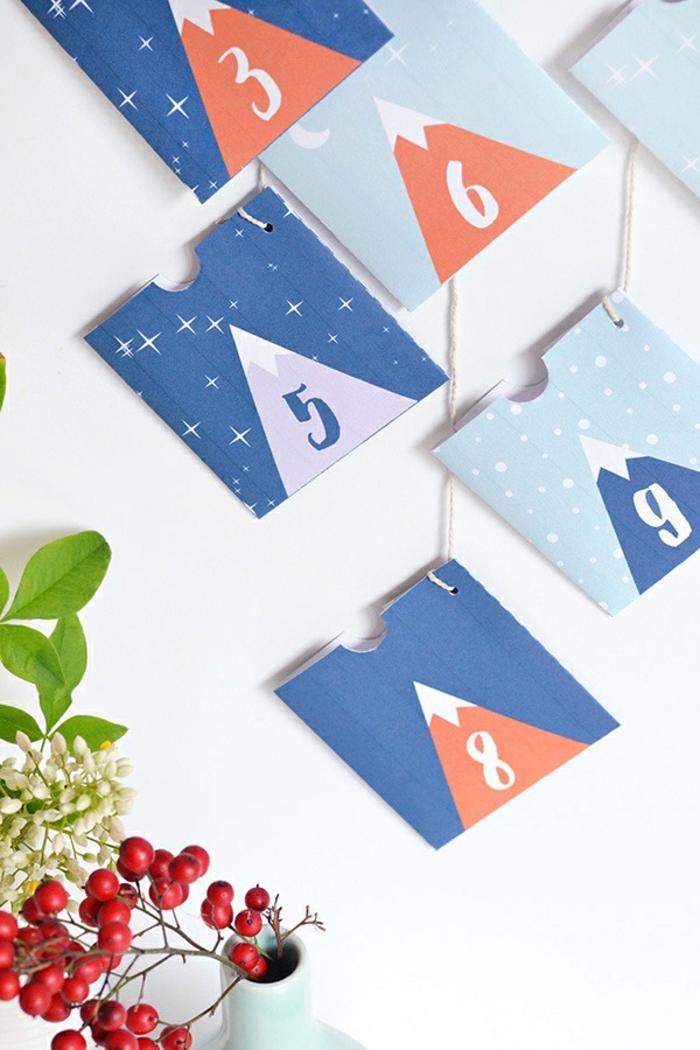 Adventskalender aus bunten Papiertüten selber machen, mit kleinen Geschenken befüllen