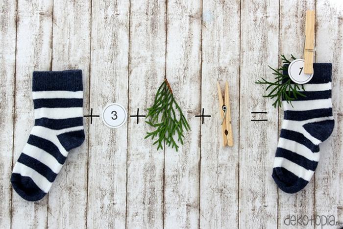 Adventskalender einfach und schnell selber machen, Socken voll mit kleinen Geschenken mit Wäscheklammern befestigen