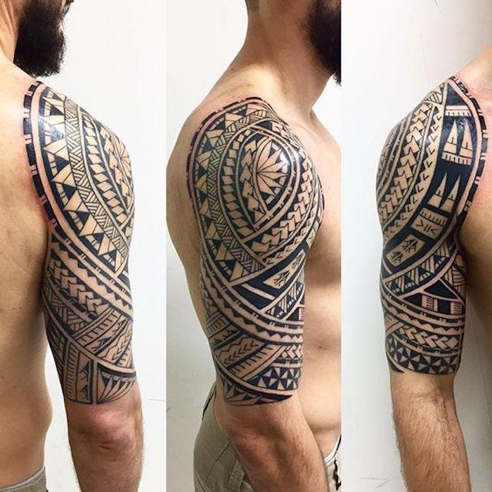 maori tattoo arm - ein junger mann mit einem bart und mit einer hand mit einem großen schwarzen maori tattoo