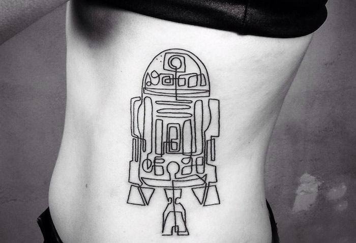 idee fpr einen star wasrs tattoo für frauen - ein weißer star wars roboter - stra waars empire tattoo