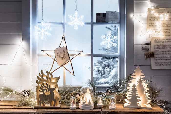 fensterdeko basteln stern deko leuchtende dekorationen renntier tannenbaum weihnachtsbaum kerzen deko ideen