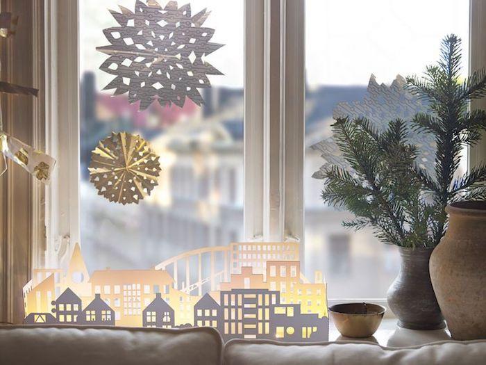 weihnachtliche deko dezente deko ideen mit schneeflocken und sterne kleine häuser leuchten dekorieren