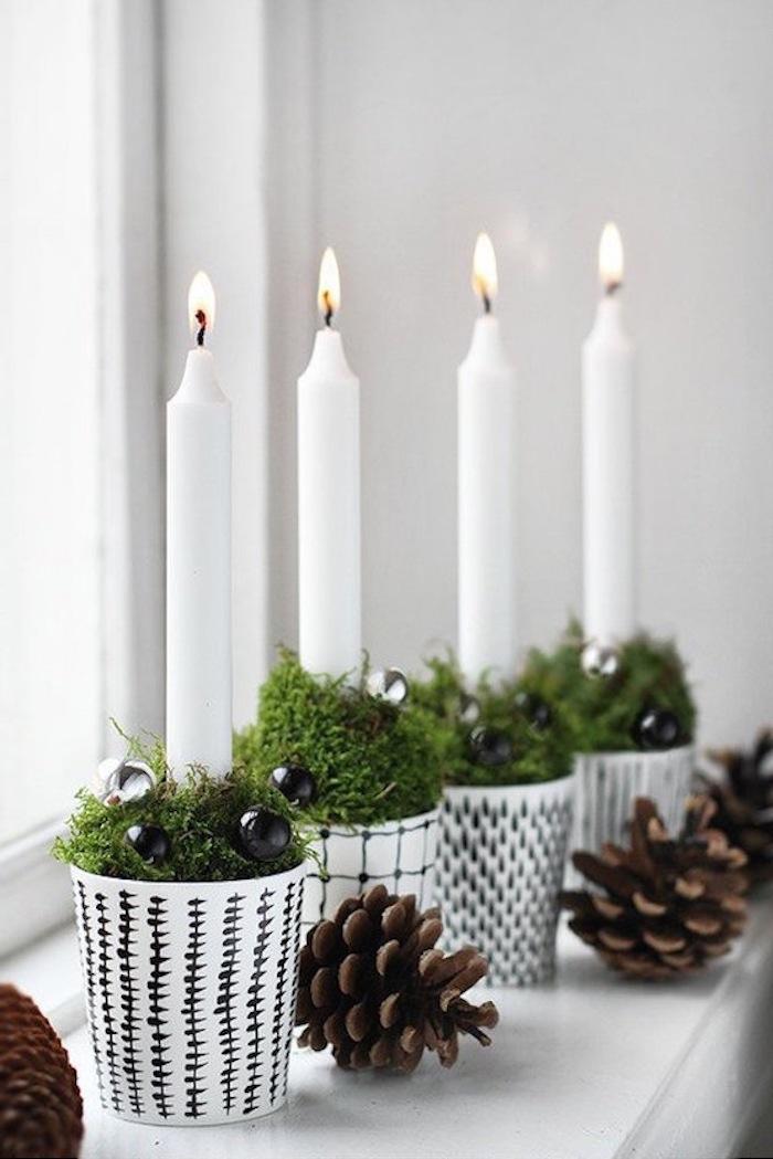 weihnachtsdeko fenster weiße topf gestaltungen zapfen kerze grüne deko ideen leuchtende kerzen