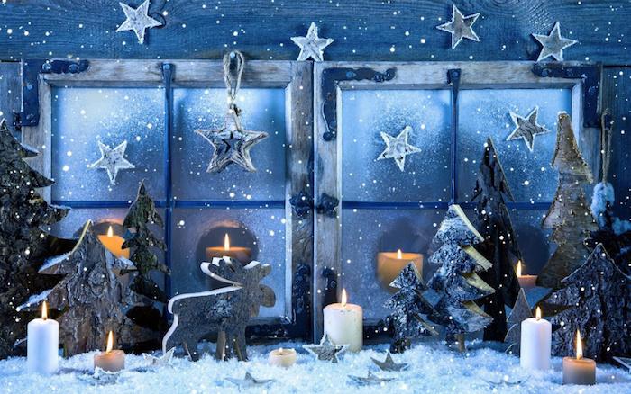 weihnachtsdeko fenster blaues design deko idee stern kerze schnee tannenbäume