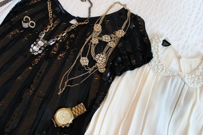 breite schwarze Damenbluse mit kurzen Ärmeln und Kupfer-Pailletten, weiße Satinbluse mit Bubikragen mit weißen Perlen, Halskette mit Kristallen, Ohrringe mit schwarzem Stein, Halsschmuck aus Kupfer, Armbanduhr aus Kupfer, Schmuck mit Kupferüberzug
