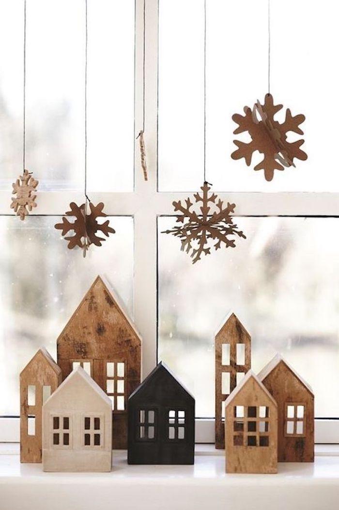 weihnachtsfensterdeko sterne und schneeflocken fliegen über die häuser holzhaus figuren deko