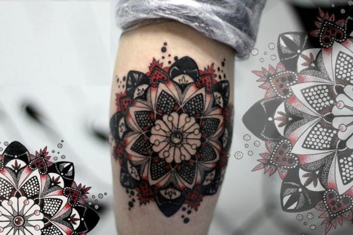 schönes Armtattoo in Rot und Schwarz mit kleinen weißen Kreisen und schwarzen Punkten in unterschiedlichen Größen, Tattoomuster mit Herzen- und Punktenmotiven in Weiß