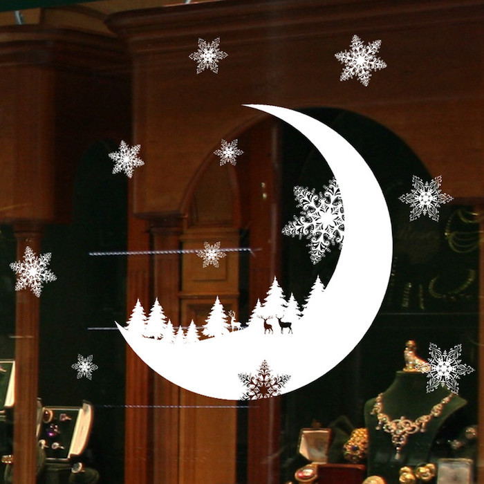 weihnachtsbeleuchtung fenster mond deko sticker für fenster schneeflocken aufgeklebt am fenster