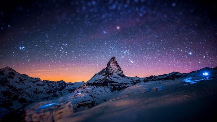schöne winterbilder - ein blauer himmel mit vielen weißen sternen - winterberge mit schnee