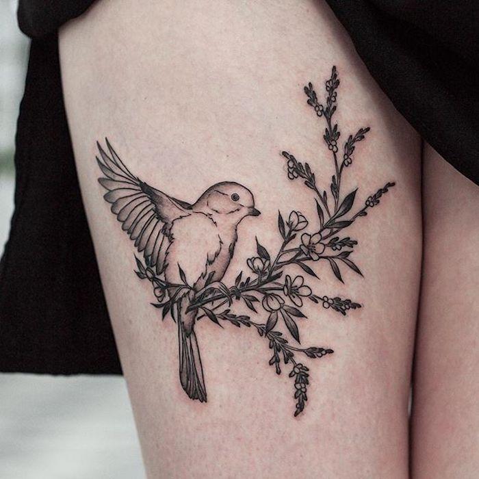 tattoo schwalbe, schwalbe am zweig, tätowierung am oberschenkel
