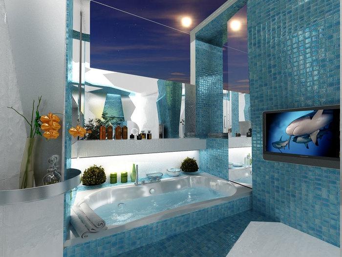 eingebaute Whirlpool-Badewanne mit Schampoo-Regal, kleine Vase mit einer gelben Blume, Wandfliesen in blauen Nuancen, Badezimmer mit Fernseher
