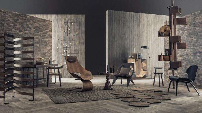Wohnzimmer wie ein Kunstobjekt, graue Naturstein Verblunder, drei Sessel und ein Couchtisch