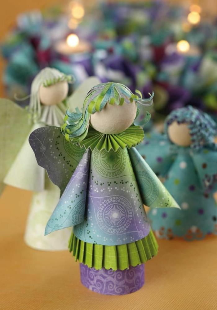 engel basteln kinder engel aus papier basteln drei engel aus papier in grün und lila weihnachtsengel basteln