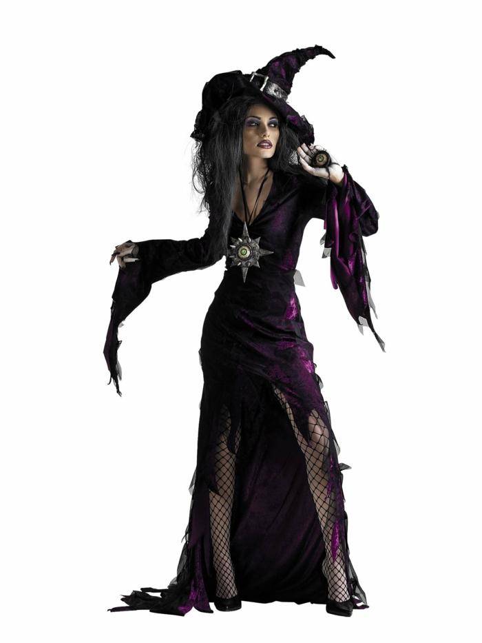 Hexen-Verkleidung zum Fasching - zerrissenes lila Kleid mit langen freifallenden Ärmeln kombiniert mit einem Netzstrumpfhose und schwarzen Schuhen mit Absatz Hexenhut mit schwarzem Gürtel