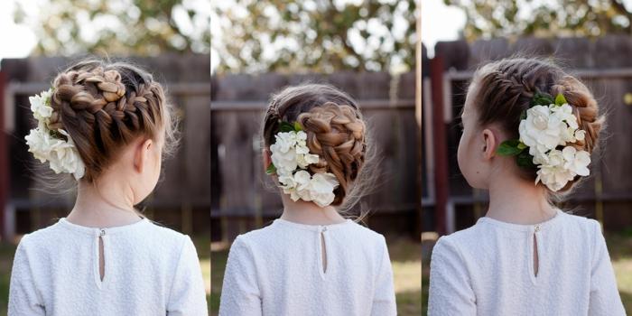 Kinderfrisuren, ein blondes Mädchen mit Dutt, weiße Blumen als Haarschmuck