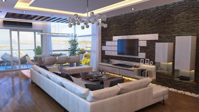eine moderne Wohnung mit Terrasse, Wandverblender in grauer Farbe, weißes Sofa