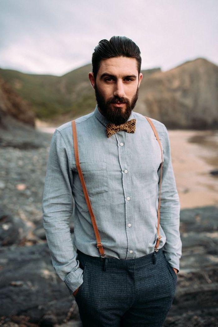 bart wachsen lassen eleganter mann graues outfit nuancen des grauen hosenträger gentleman club hemd mit fliege