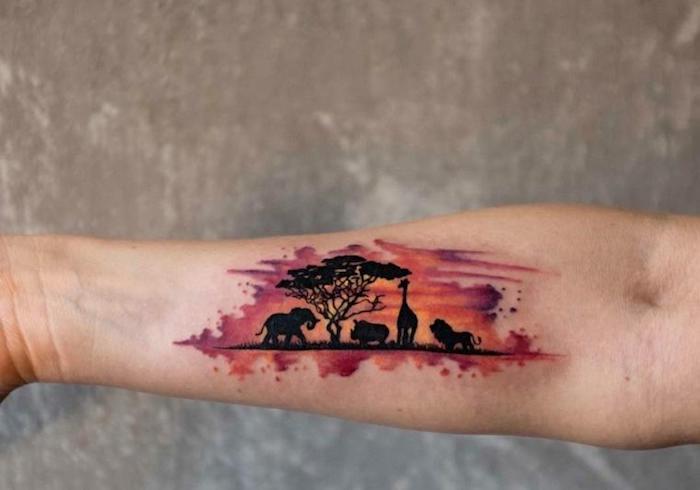 schöne tattoos, farbige tätowierung am arm, afrika, tiere
