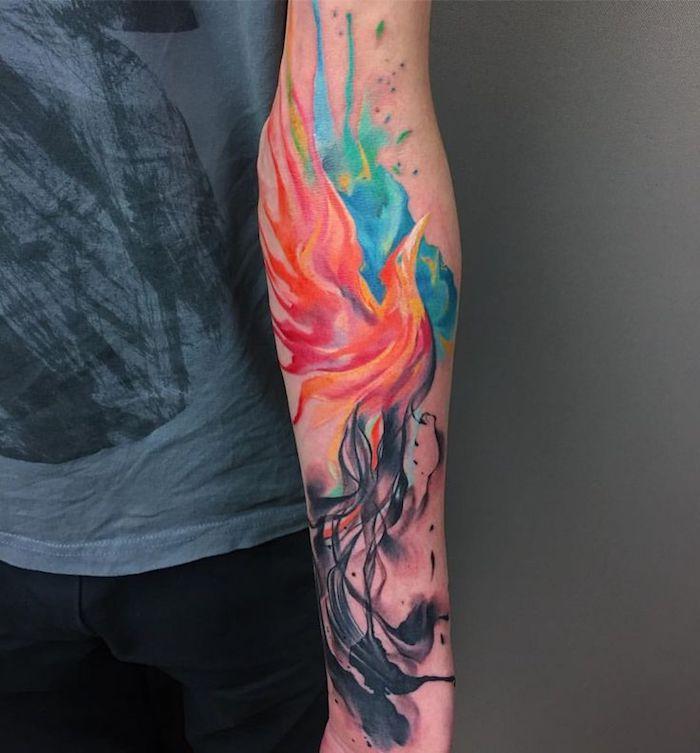 tattoo freiheit, wasserfarben tattoo am unterarm, phönix