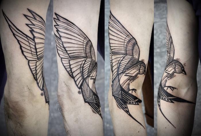 tattoo vogel, schwarz-graue tätowierung mit schwalben-motiv am arm