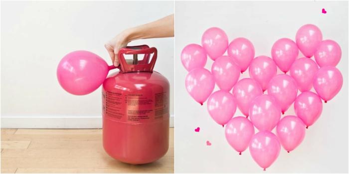 Herz aus rosafarbenen Luftballons, romantische Überraschung zum Valentinstag, kleine Herzen an der Wand