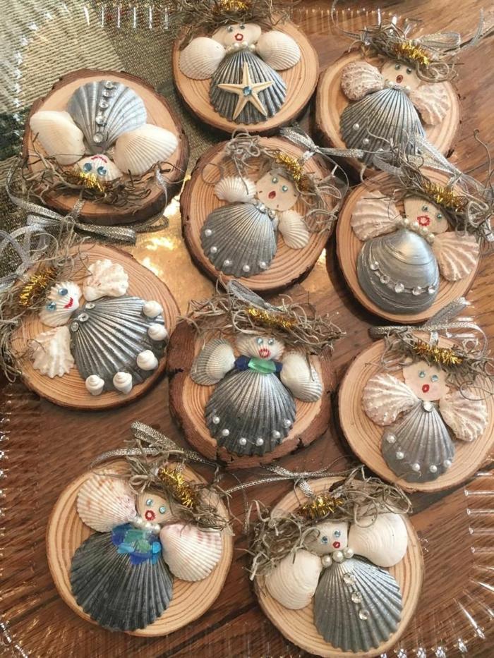 weihnachtsdeko engel basteln schöne engel basteln muschelschale und holzscheiben silber verschiedene varianten
