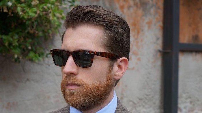 Kurzhaarfrisur und Hipster Bart, schwarze Sonnenbrille, dicke und glatte Haare