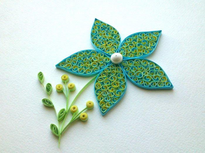 kleine und große grüne quilling blumen mit grünen blättern aus quilling papierstreifen, paper quilling, bastelideen frühling
