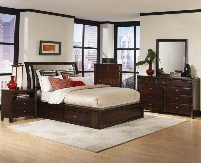 weiße Wände, ein Bett mit beiger Decke, ein grauer Teppich, Schlafzimmer modern einrichten