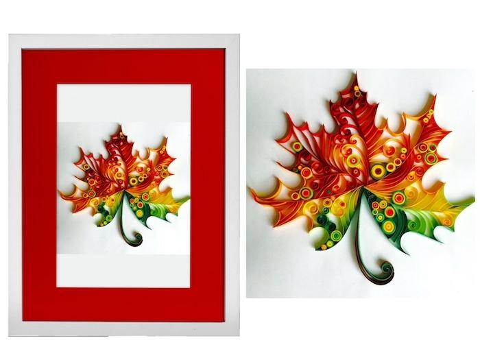 eine rote karte mit einem quilling blatt, frühling basteln mit papierstreifen, blatt mit rotten, grünen, gelben und orangen quilling papierstreifen