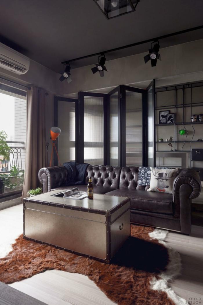 das Wohnzimmer und das Arbeitzimmer teilen - mobile Trennwand aus Glas mit schwarzen Rahmen