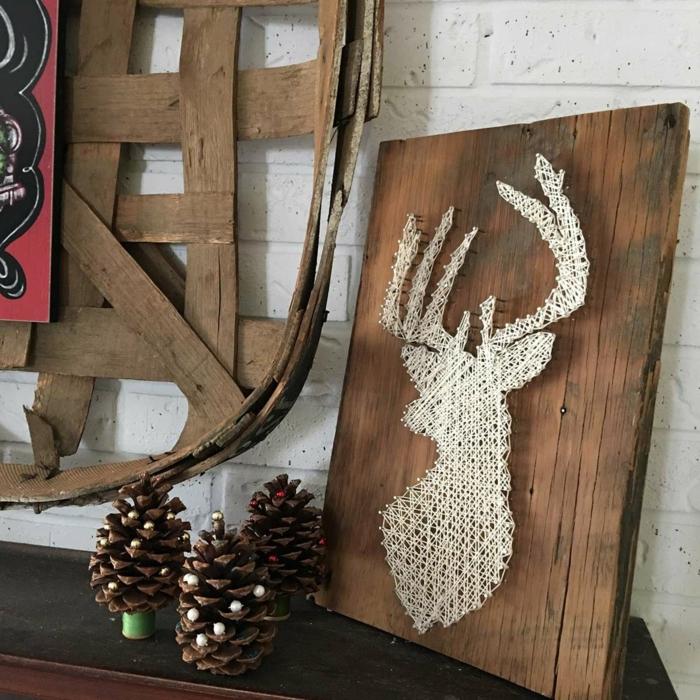 eine Deko in Landhausstil, Nagelbild Anleitung für Hirsch mit weißen Fäden