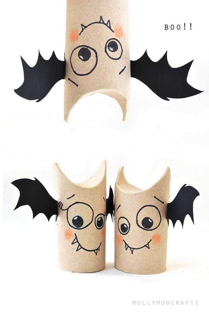 drei kleine fledermäuse mit schwarzen augen, zähnen und schwarzen flügeln aus papier, fledermäuse aus klorollen, eine fledermaus malen