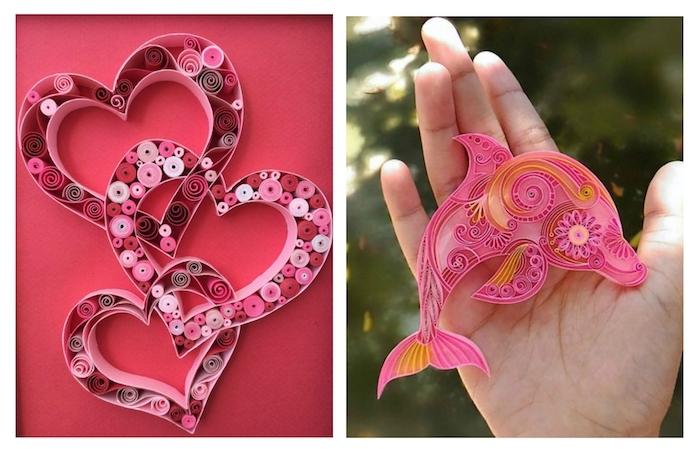drei pinke quilling herzen, eine hand mit einem kleinen pinken quilling delfin aus pinken und orangen papierstreifen