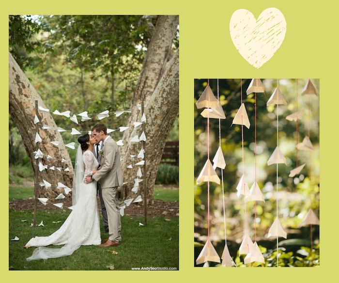 ein bild mit einem großen herzen, papierflieger selber machen, eine hochzeit und ein liebespaar, hochzeitsdekoration mit vielen weißen papierliegern, ein garten mit bäumen mit grünen blättern