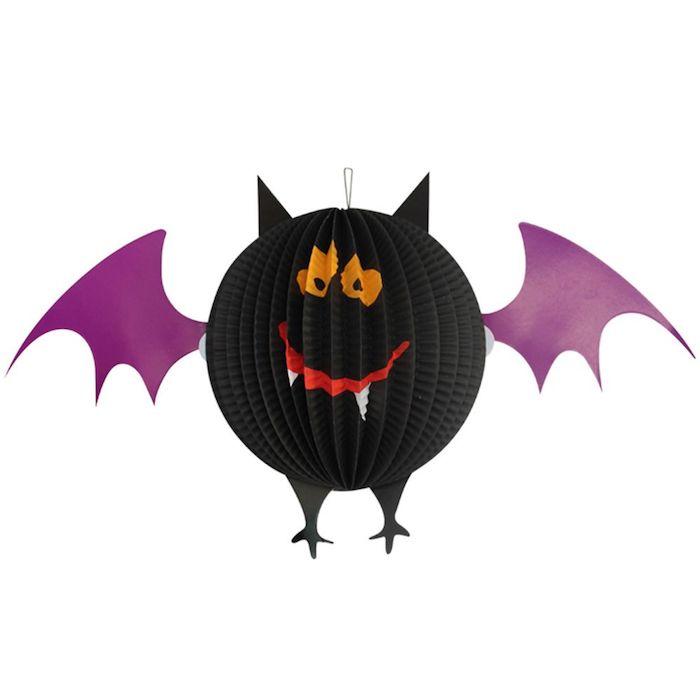 eine fledermaus laterne basten, bastelideen für erwachsene, eine schwarze fledermaus mit violetten flügeln aus papier und mit weißen zähnen und orangen augen