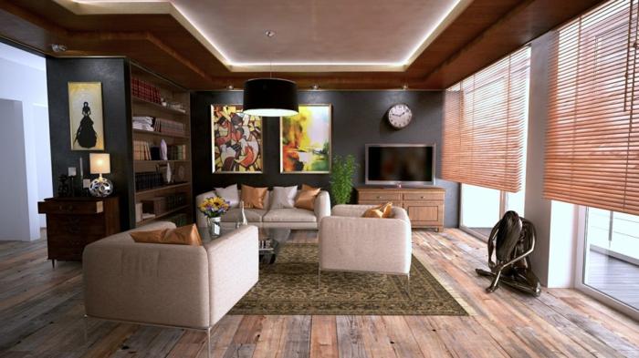 schöne Wohnwand mit einem Regal, Fernsehwand und zwei Bilder, grüner Teppich, beige Möbel