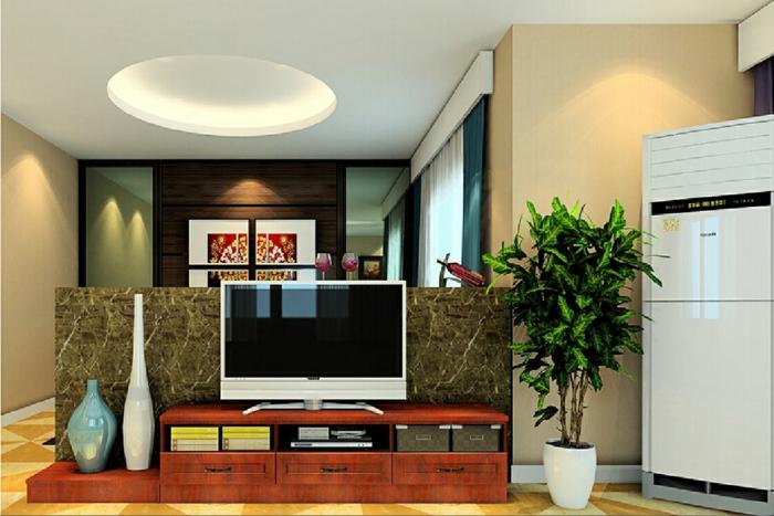 eine Trennwand Wohnzimmer, ein weißer Fernseher, große grüne Pflanze in der Ecke
