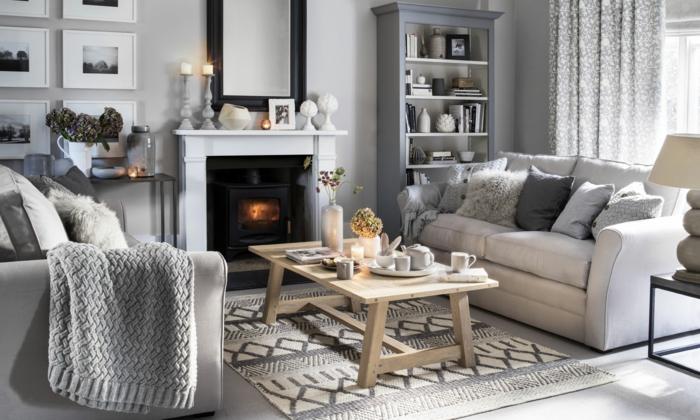 ein Wohnzimmer in Weiß und Grau, Wohnwand selber zusammenstellen, Bilder, Regale und Kamin
