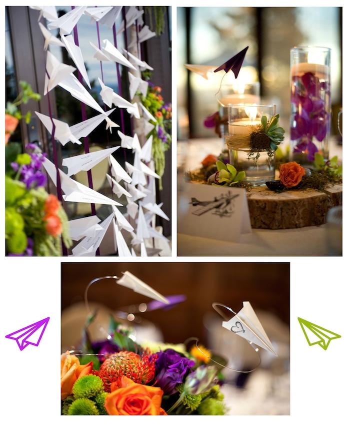 ein tisch mit deko mit kerzen, kleinen grünen, violetten und orangen pflanzen und holz und kleinen weißen und violetten papierfliegern