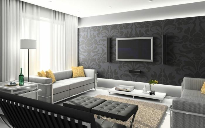 grau gestrichene Wohnwand selber zusammenstellen, zwei graue Sessel, zwei Hocker, ein brauner Teppich