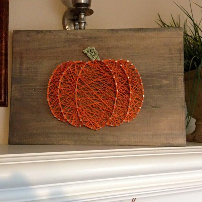 eine orange Fadengrafik Anleitung, ein Kürbis, eine perfekte Dekoration zu Halloween
