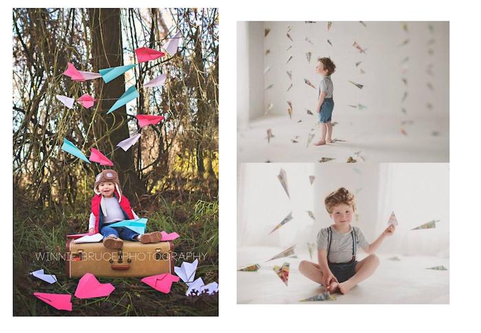 ein wald mit bäumen, kleines kind und ein großer koffer, viele pinke, blaue und violette herzähnliche große papierflieger, ein zimmer mit weißen wänden und mit deko mit papierfliegern