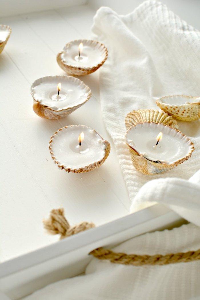 muscheln basteln, selbstgemachte teelichthalter aus muscheln, sommerdeko, kerzen