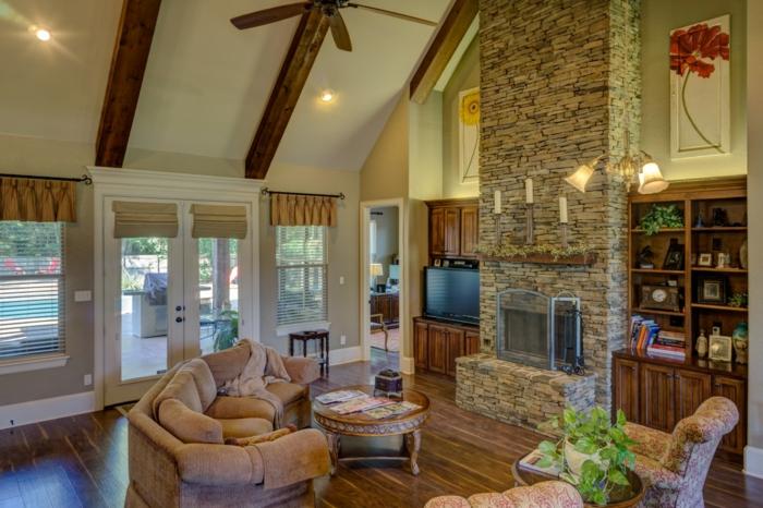 Steinwand selber machen, über dem Kamin, bequeme Wohnzimmermöbelm Regale und Fernsehwand