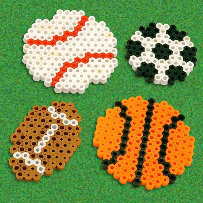 Bügelperlen Ideen - vier Figuren von Bällen, ganz realistisch für Sportfans